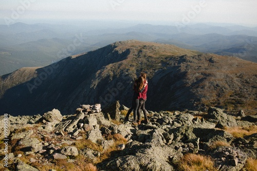 Photo  Couple Hugging on Top of A Mountain