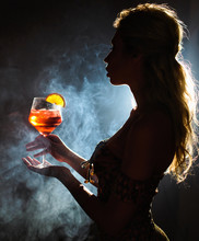 Beautiful Young Woman Profile In Backlight Drinking Aperol Spritz Isolated Black Background With Smoke. Club Party Menu Concept