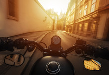 POV Shot Of Man Riding On A Motorcycle. Hands Of Motorcyclist On A Streets Of Prague Historical Centre, Czech Republic.