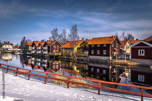 Fototapety, obrazy: Falun - March 30, 2018: The picturesque wooden houses in the center of the town of Falun in Dalarna, Sweden