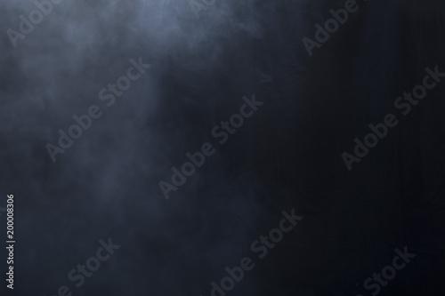 Fog/haze covers left side of screen over a black background Wallpaper Mural