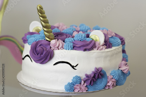 Close Up Of Unicorn Cake With Pink Blue And Purple Colors Flowers Made For Birthday