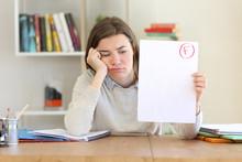Sad Student Showing Failed Exam