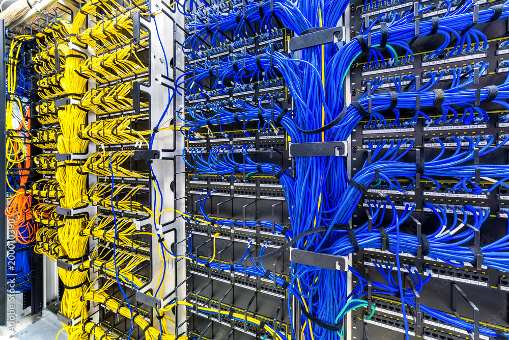 Fototapeta Rack with generic ethernet cat5e cables, part of a large company data center.