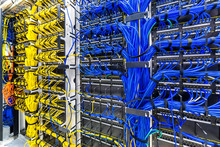 Rack With Generic Ethernet Cat5e Cables, Part Of A Large Company Data Center.