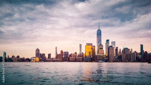 Photo Stands New York Lower Manhattan at sunset viewed from Jersey City, New Jersey