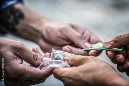 Photo  Drug addict buying narcotics and paying