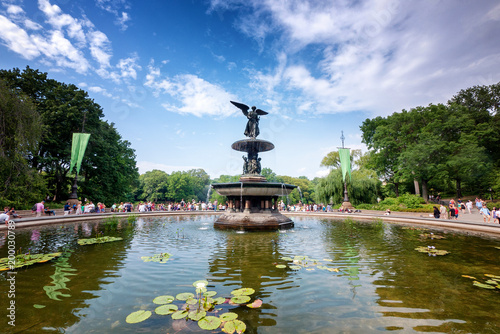 фотография  Bethesda Pool and its famous statue in Central Park in New York City on a summer