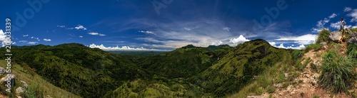 Foto op Aluminium Nachtblauw Panoramic view from Adam's peak small Ella. Woman standing at touristic viewpoint. Beautiful place of Sri lanka