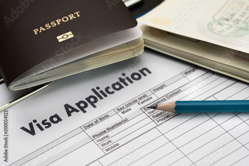 Obraz na plátně Visa application form to travel Immigration a document Money for Passport Map an