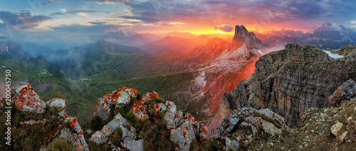 Panorama dramatic sunset in dolomites alp mountain from peak Nuvolau