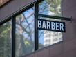 Modern Barber sign hanging outside the shop
