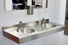 Metal Sink With Taps In Public Toilet