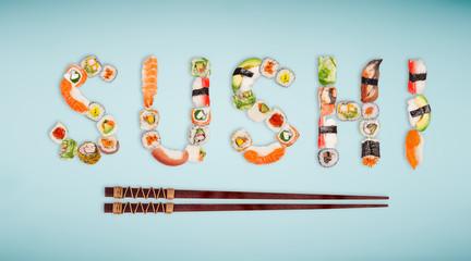 Fototapeta Sushi Traditional japanese sushi pieces making inscription.