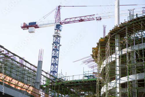 Construction crane and building against clear sky