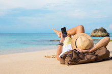 Guy With Smartphone Lying On The Beach