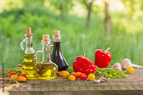 vegetables with oil on wooden table outdoor