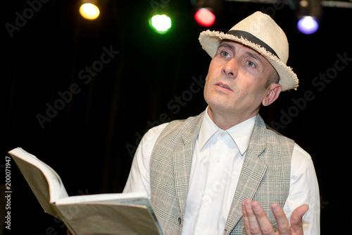 Fotografie, Obraz Man reading poetry on stage