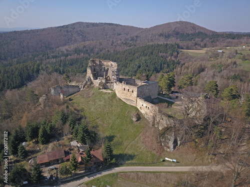 Papiers peints Cappuccino Kamenets, near Odjykon, Poland -april 8, 2018: Ancient ruins of a medieval castle against the backdrop of a natural landscape of the central strip of central Europe. View of drone. Panorama of fly.