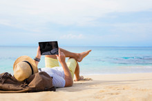 Man With Tablet On The Beach