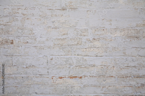 Photo Old scratched white brick wall. Texture.