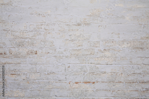 Old scratched white brick wall. Texture. Wallpaper Mural