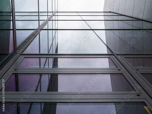 The glass architecture in city against a sky Canvas Print