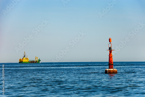 Photo Navigation buoy at the edge of a fairway.