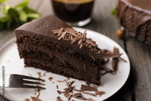 Poster Dessert chocolate cake on wood background.