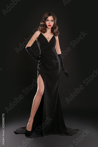 Elegant Lady In Long Sexy Dress With Retro Wavy Hairstyle Posing