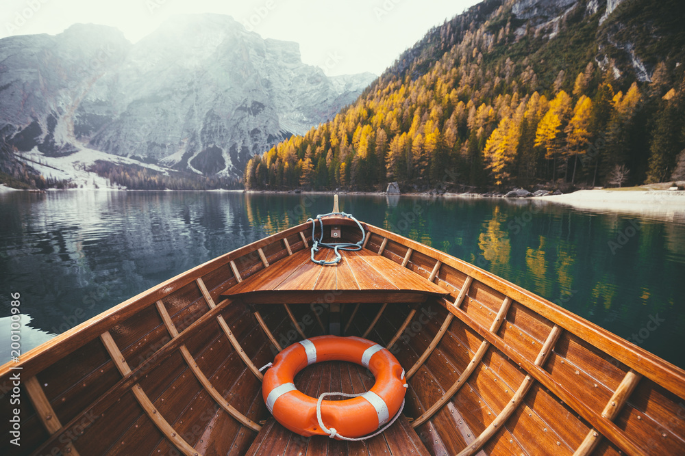 Fototapety, obrazy: Traditional rowing boat on a lake in the Alps in fall
