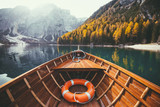 Fototapeta  - Traditional rowing boat on a lake in the Alps in fall