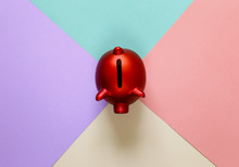 Red Piggy Bank On A Colorful Background