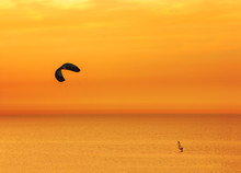 Sunset Over The Sea And Extreme Freestyle Sports Windsurfing In Israel.