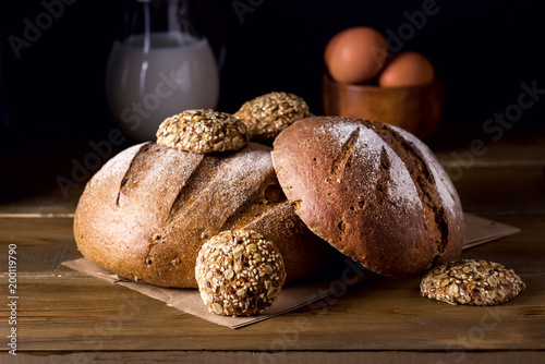 Variety of Loafs Fresh Baked Rye and Whole Grain Bread on Wooden Texture Background Dark Photo Variety of Bread