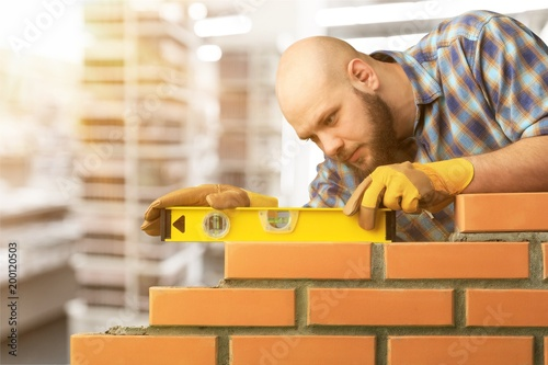Fototapety, obrazy: Bricklayer.