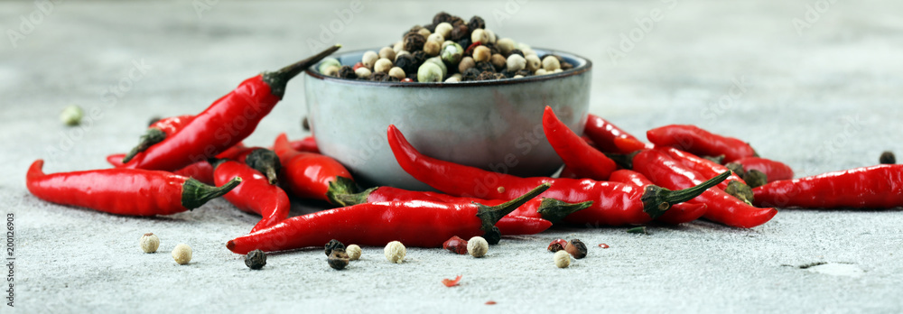 red hot bird chili pepper with pepper corns