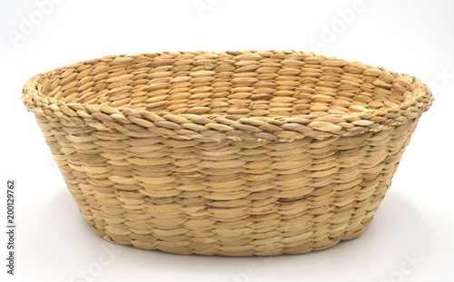 Leinwand Poster vintage empty weave wicker basket isolated on white background