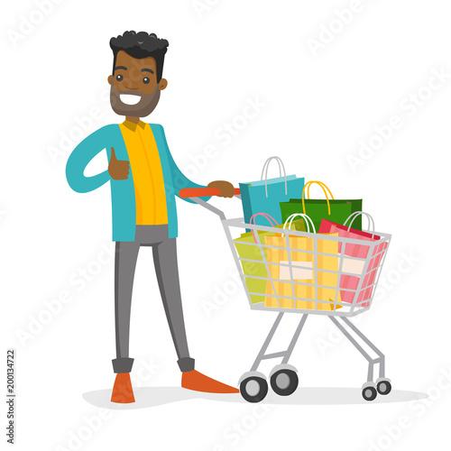 Fotografía  African-american man pushing cart full of shopping bags