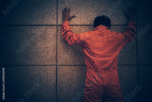 Photo Portrait of asian handsome man in Prison uniforms,He has a lot Mustache and mess