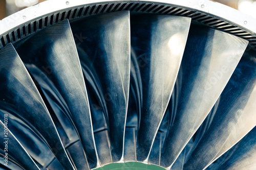 Turbine blades of turbo jet engine for plane, aircraft concept in aviation industry