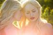 Leinwandbild Motiv Women with blonde hair and makeup outdoor.