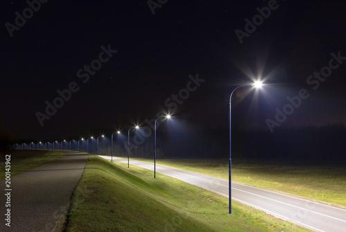 Valokuva  empty street at night with modern LED streetlights