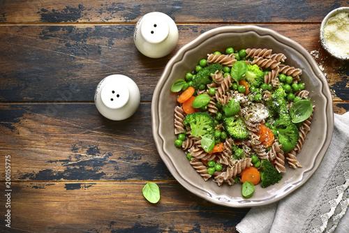 Fotografie, Obraz  Whole wheat pasta primavera.Top view with copy space.