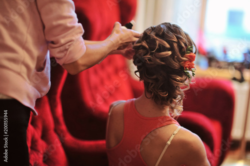 Deurstickers Kapsalon Close up of a beautiful wedding hairstyle with fresh flowers. Orange color