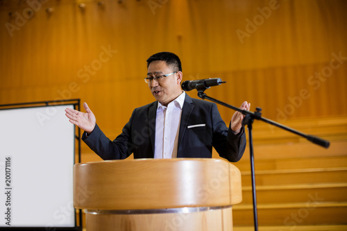Male business executive giving a speech