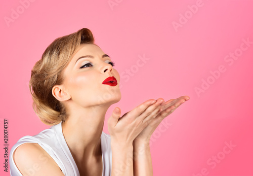 Skincare, haircare, beauty concept - woman with perfect skin, red lips blowing kiss from hand Poster Mural XXL