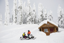 Couple Riding Snowmobile In Sn...