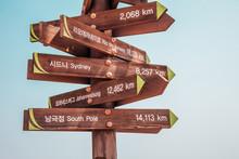 Wooden Arrow World Landmarks Signpost
