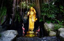 Golden Buddha Statue In The Garden